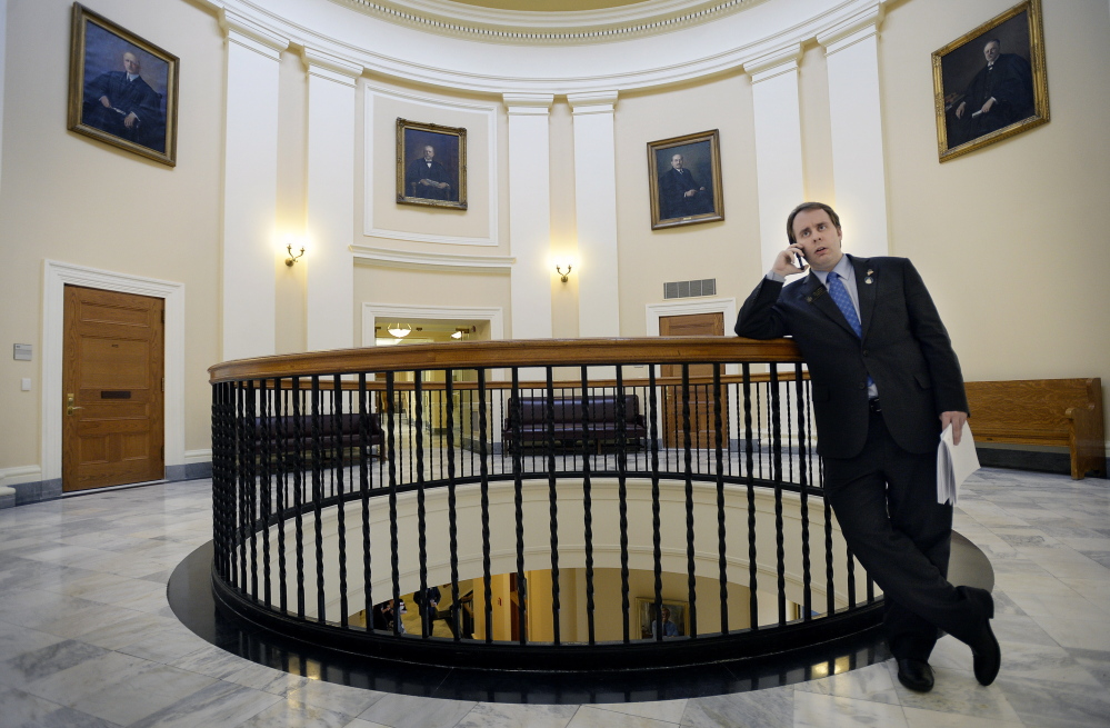 State Sen. Eric Brakey talks on the phone with a reporter at the State House in Augusta. He emerged from political obscurity two years ago when he led a contingent of Ron Paul supporters that unexpectedly took over the Maine Republican State Convention.