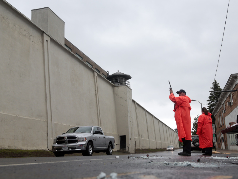 A state corrections officer monitors traffic passing Clinton Correctional Facility on Monday, in Dannemora, N.Y.