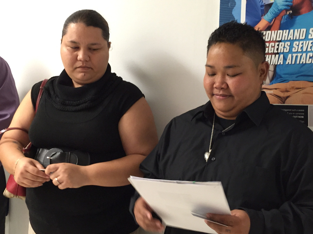 Loretta M. Pangelinan, right, holds the application for a marriage license that she and her fiancee, Kathleen M. Aguero, turned in at the Office of Vital Statistics in Guam.