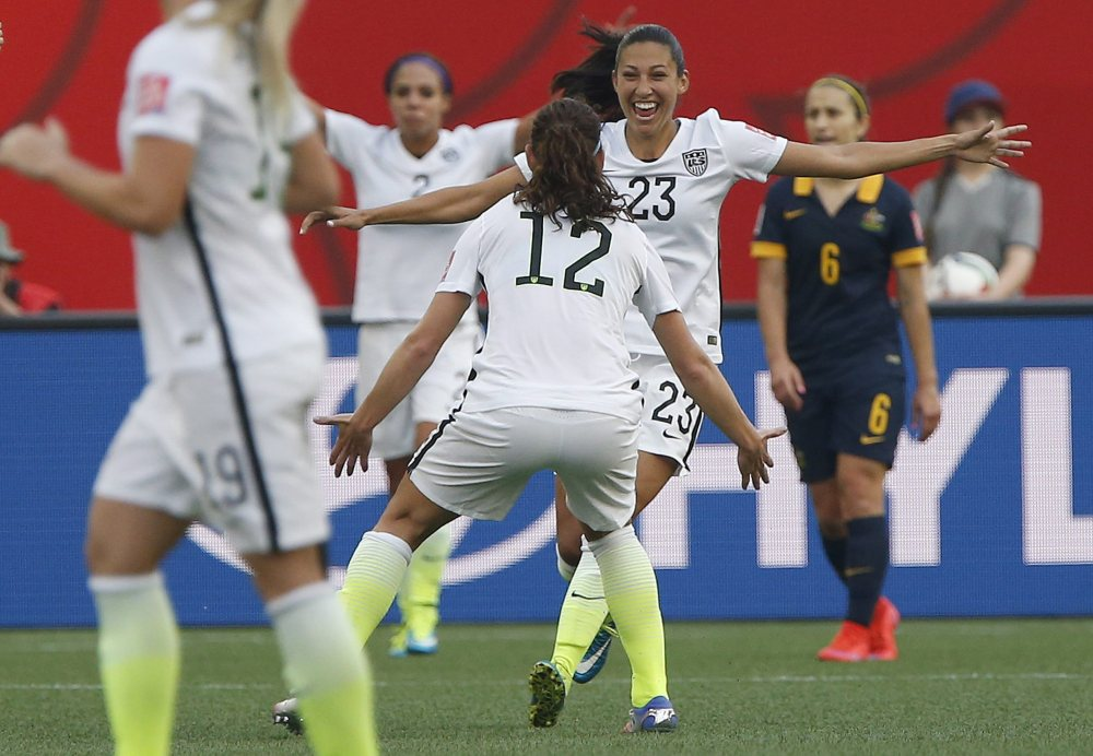 The United States' Christen Press celebrates her tie-breaking goal against Australia with Lauren Holiday (12) during Monday's Women's World Cup soccer match in Winnipeg, Manitoba.
