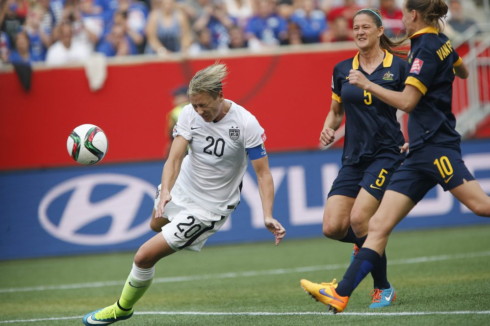 Abby Wambach's header goes wide against Australia in the first half Monday. The U.S. went on to a 3-1 win.