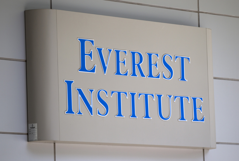A sign for the college Everest Institute is seen on an office building in Silver Spring, Md. The system of colleges was once owned by Corinthian Colleges Inc.