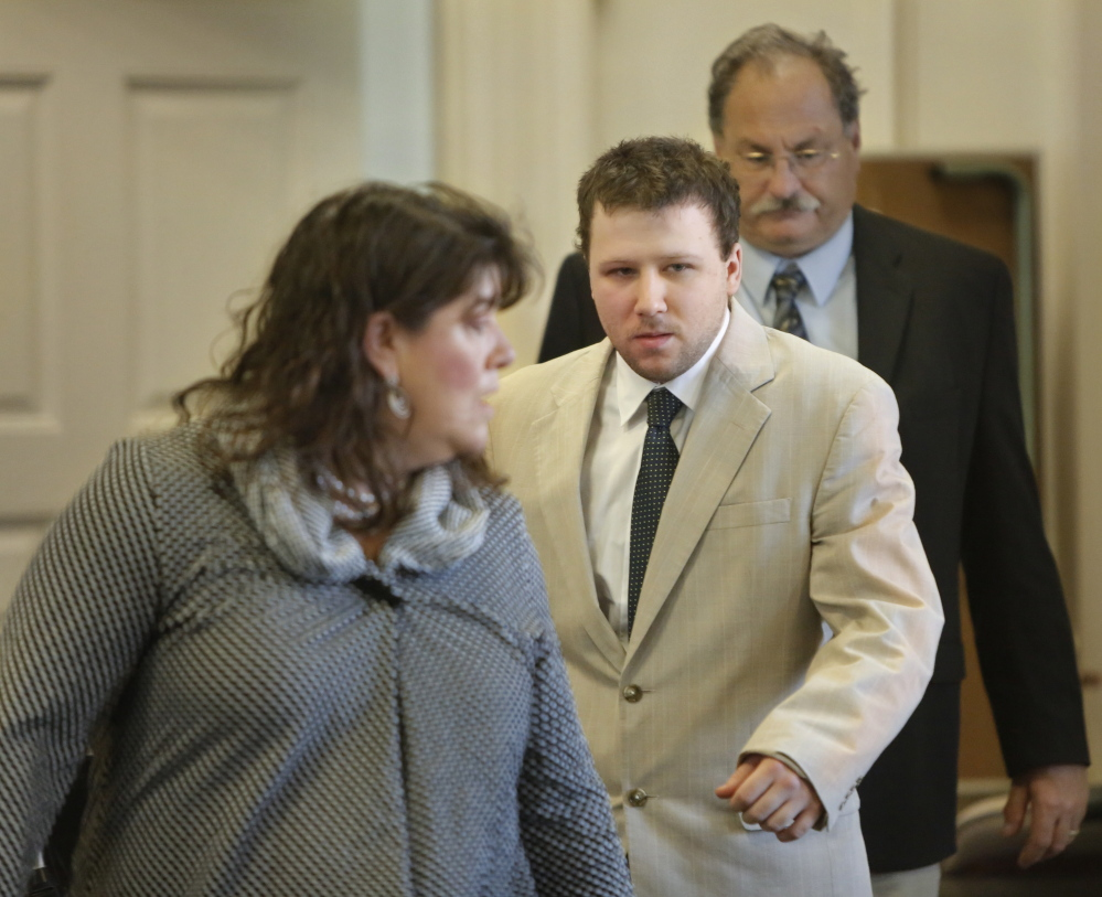 Derek Poulin follows his attorney Amy Fairfield into York County Superior Court in Alfred for the opening of his murder trial on Thursday. Poulin is accused of killing his grandmother Patricia Noel and setting her Old Orchard Beach home on fire in 2012.