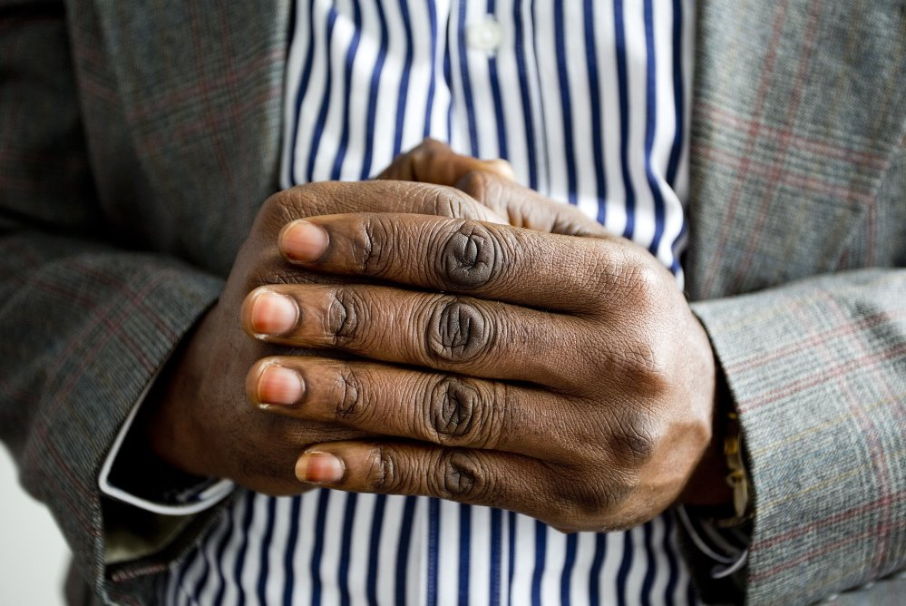 An asylum seeker in Portland, who asked that he not be identifiable because he fears that speaking out would endanger his family in the Democratic Republic of Congo.