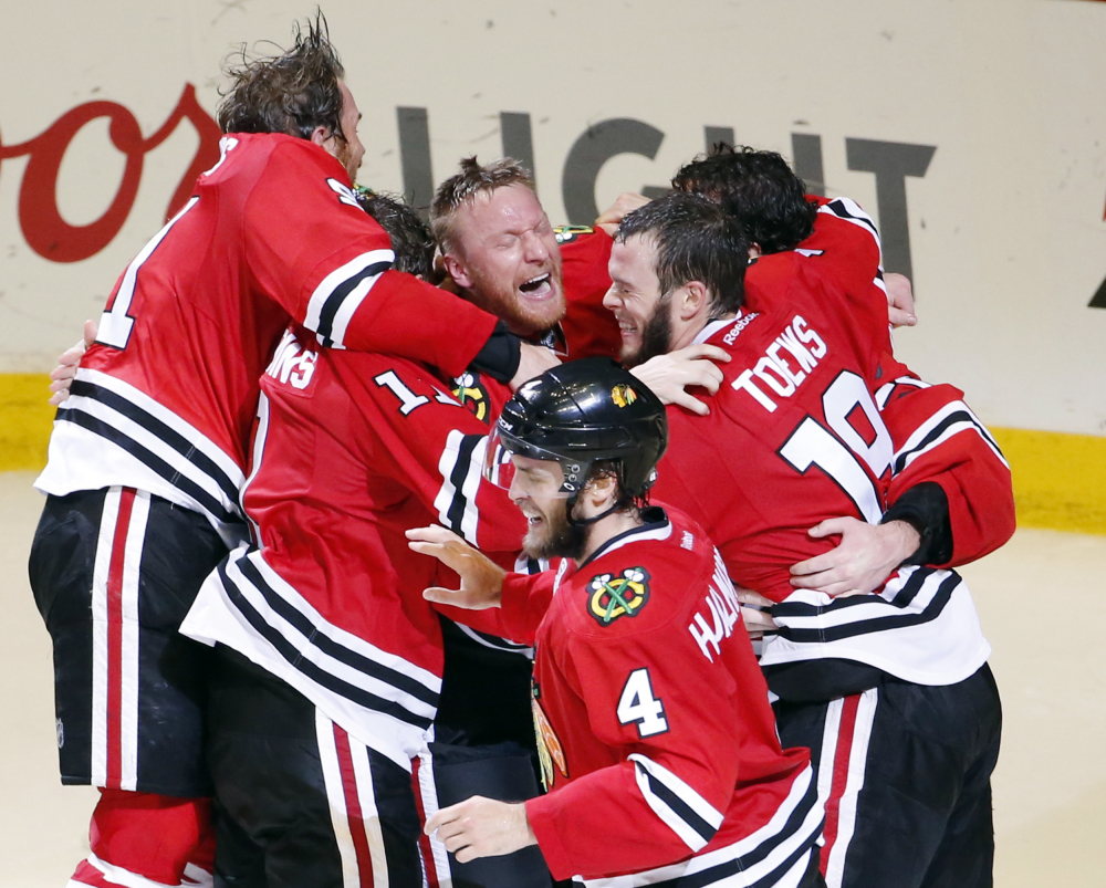 The Chicago Blackhawks celebrate a Stanley Cup championship after defeating the Tampa Bay Lightning on Monday night in Chicago. The Blackhawks defeated the Lightning 2-0 to win the series 4-2 and clinch the cup on home ice for the first time since 1938.