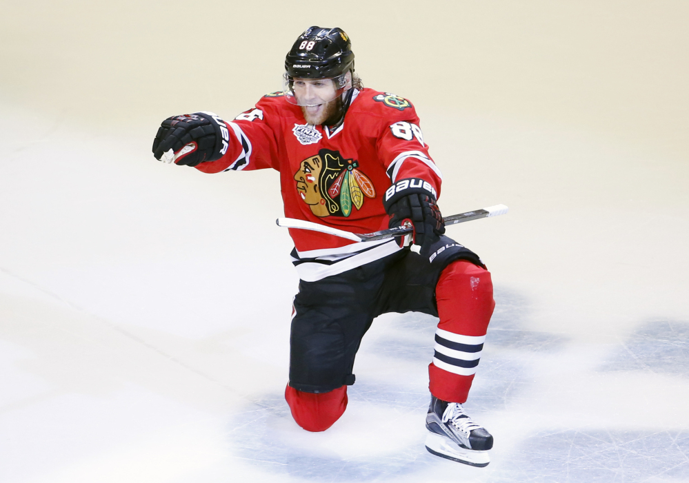 Chicago's Patrick Kane celebrates after scoring in the third period Monday night to give the Blackhawks a 2-0 lead.