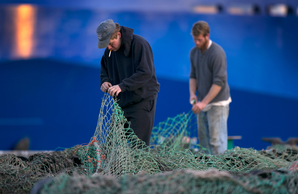 2013 Associated Press File Photo/Robert F. Bukaty Fishermen mend groundfishing nets in Portland. Regulators' recent changes to habitat affect the way fishermen catch important species including cod and scallops in federal waters from Maine to Rhode Island.