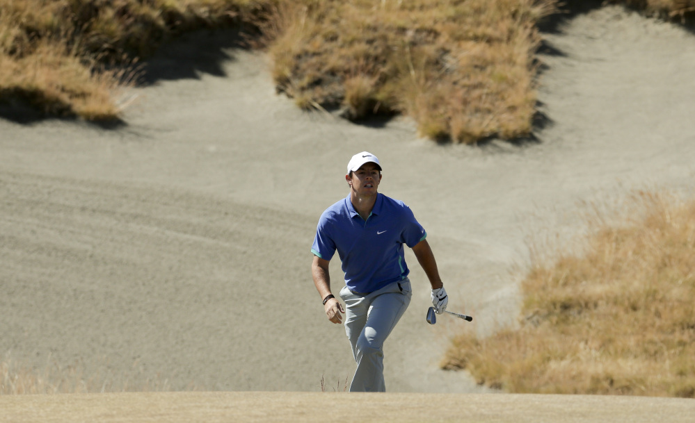 Rory McIlroy of Northern Ireland watches his bunker shot on the third hole during the third round of the U.S. Open at Chambers Bay on Saturday in University Place, Wash. The Associated Press