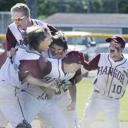 Bangor players celebrate a second consecutive Class A baseball state championship after the Rams held off South Portland for a 5-4 victory in Augusta.