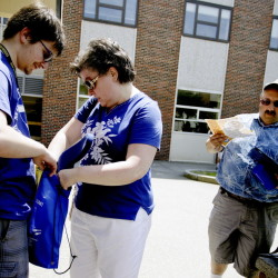 Robert Balsamo, left, of Saco gets help from his mother, Carolyn, during orientation at the University of Southern Maine in Gorham recently as his father, Tony, reviews college paperwork. To save money, Robert, 18, plans to live at home and commute to school.