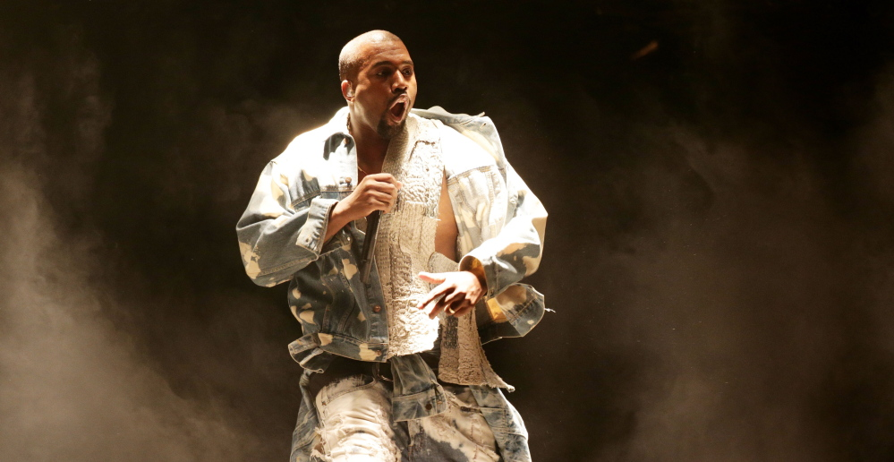 """Kanye West performs at Britain's Glastonbury Festival and declares himself """"the greatest living rock star on the planet."""""""