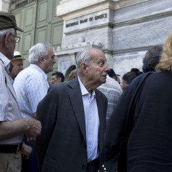 A pensioner is told by an employee Monday that he is not going to receive his pension after waiting for hours outside the national bank of Greece in Athens.  The Associated Press