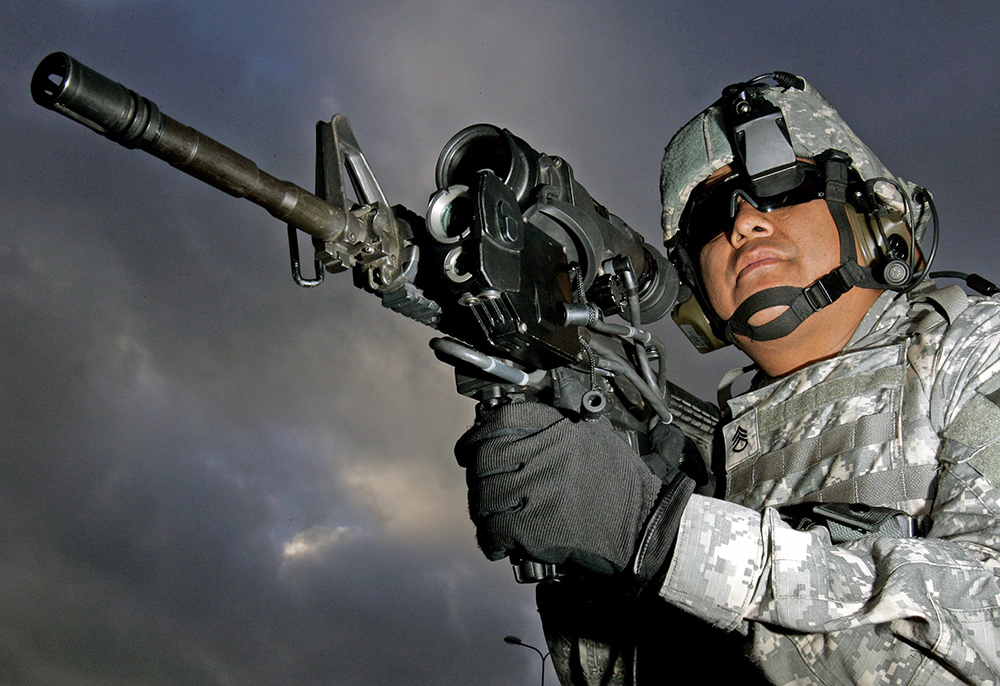 U.S. Army Staff Sgt.  Ruben Romero fires an M4 with magnifying video camera and thermal imaging in this  2006 photo.  The military has relied solely on Colt Defense of Hartford, Conn., to make the M4s. The Associated Press