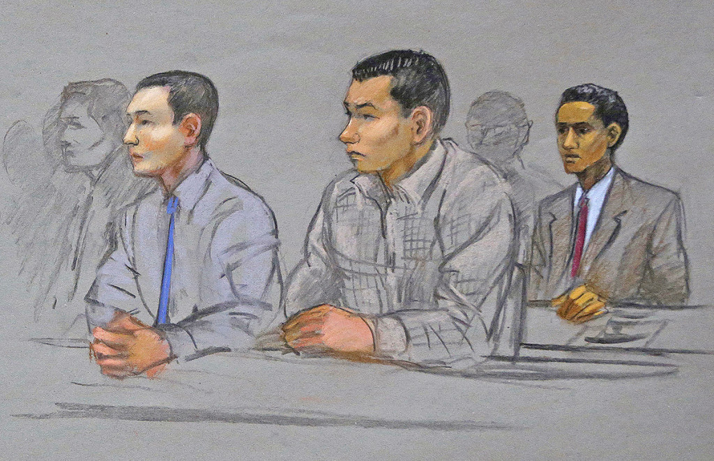 In this courtroom sketch, defendants Azamat Tazhayakov, left, Dias Kadyrbayev, center, and Robel Phillipos, right, college friends of Boston Marathon bombing suspect Dzhokhar Tsarnaev, listen during a hearing in federal court on May 13, 2014, in Boston. Sketch by Jane Flavell Collins via AP