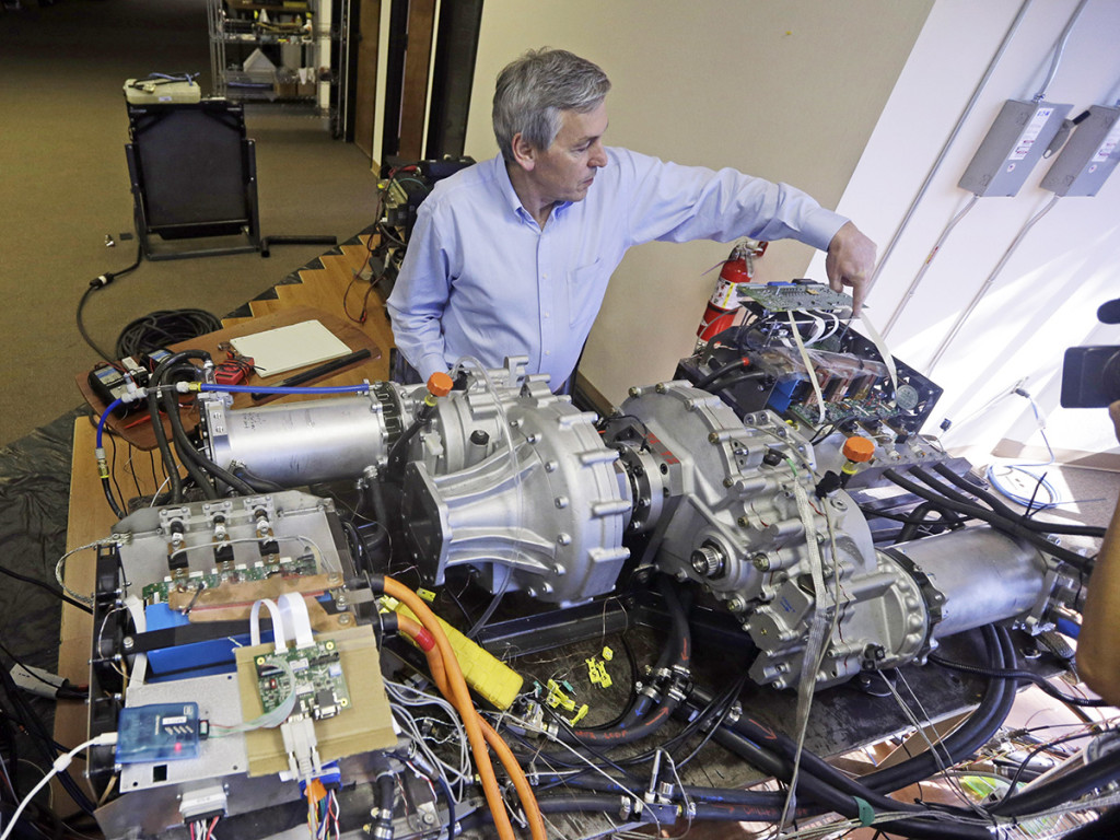 Wrightspeed's Ian Wright explains the technology behind an electric-powered engine that will be used for FedEx delivery trucks. The Associated Press