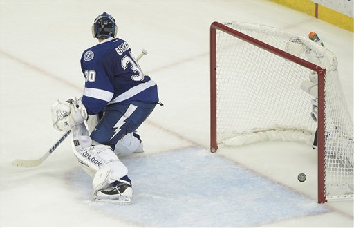 Tampa Bay Lightning goalie Ben Bishop watches as Chicago Blackhawks left wing Teuvo Teravainen scores a goal during the third period in Game 1 of the  Stanley Cup Finals in Tampa, Fla., Wednesday.  The Blackhawks defeated the Lightning 2-1. The Associated Press