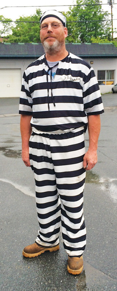 James Lowe of Barnet, Vermont, poses for a photo Tuesday after a judge  told him to leave the Caledonia County Courthouse in St. Johnsbury for wearing prison stripes and matching beanie to jury selection. Dana Gray/The Caledonian Record via AP