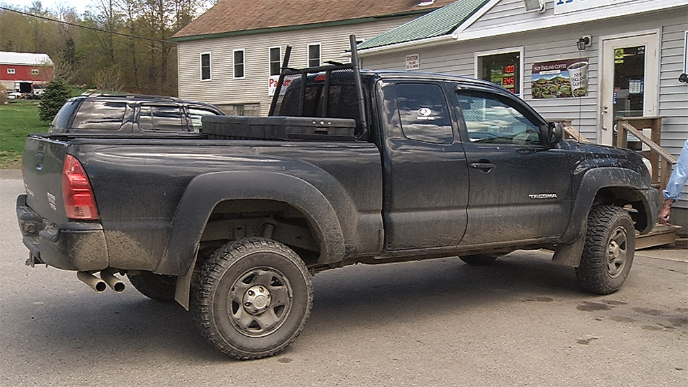 Robert Burton is believed to be driving this black Toyota Tacoma pickup truck with Maine wildlife license plate 489-AKJ.  Image courtesy of WABI-TV via Maine Department of Public Safety