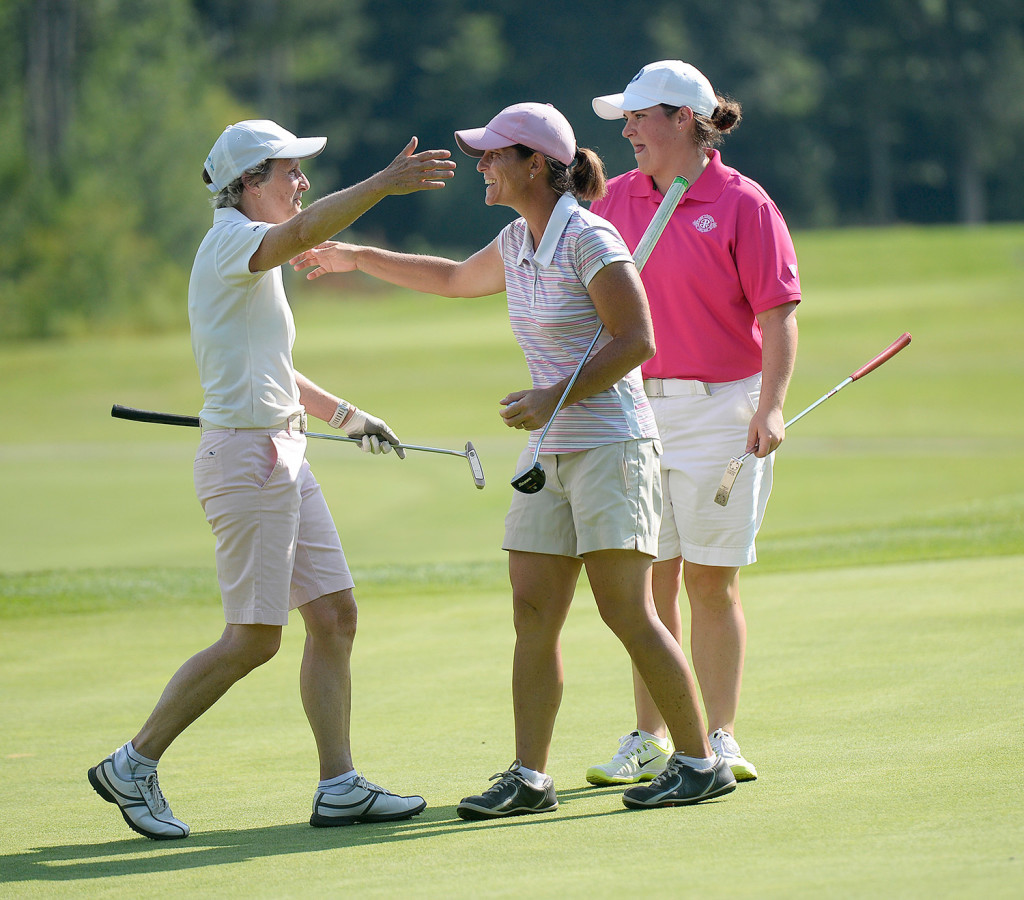 Staci Creech, center, is congratulated by Laurie Hyndman, left, and Emily Bouchard, right, after winning the Maine Women's Amateur golf tournament at the Biddeford-Saco Country Club in Saco on Wednesday.