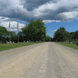 A half-mile stretch of Kanokolus Road in Unity that passes the cemetery will paved, selectmen decided Tuesday night. The gravel from the road is causing damage to Pond Cemetery.