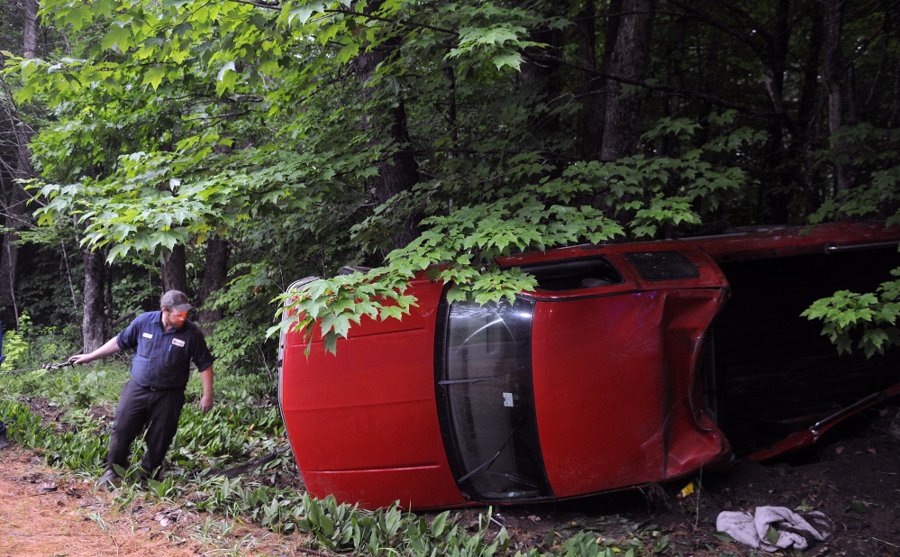 A winch is attached to a pickup that struck a tree and rolled over on the Hallowell-Litchfield Road in Litchfield. Police responded to the accident at 6:25 p.m. Wednesday and discovered that the driver, the sole occupant of the vehicle, was uninjured.