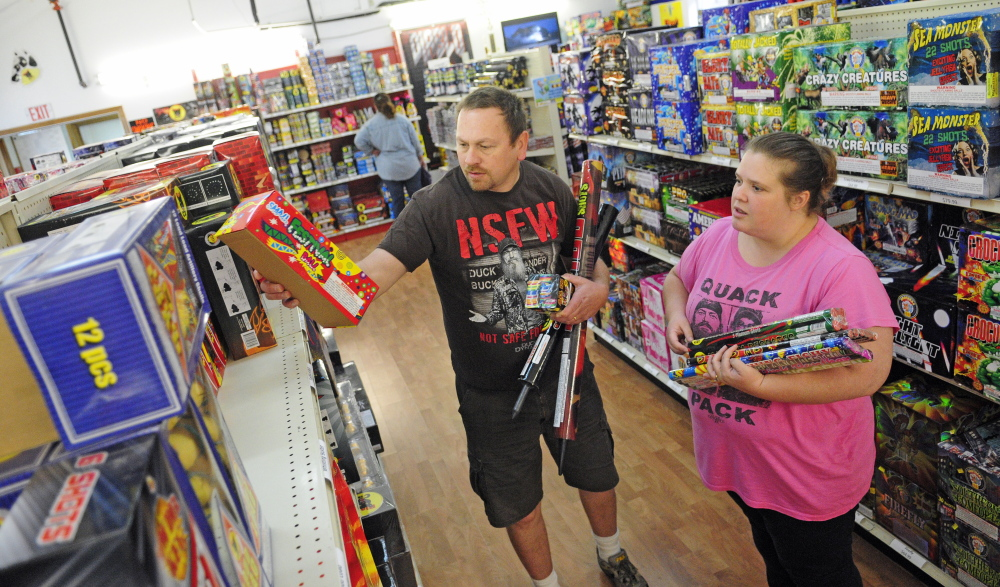 55515f8fa Scott and Holly Temple shop for fireworks Wednesday at Pyro City Fireworks  in Manchester. Staff photo by Joe Phelan