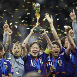 Japan players celebrate with the trophy after winning the final match against the United States at the 2011 Women's Soccer World Cup in Frankfurt, Germany. Leading up to the victory in Germany, Japan had been deeply scarred by the deadly earthquake and tsunami. The national team gave the country reason to cheer, and the players were welcomed home as heroes.