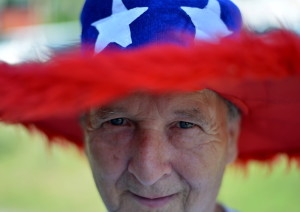 Milford Scott celebrates the holiday weekend Friday at the Winslow Family 4th of July Celebration at Fort Halifax Park in Winslow.