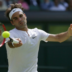 Roger Federer of Switzerland returns a shot to Sam Groth of Australia during their singles match at the All England Lawn Tennis Championships in Wimbledon, London, Saturday.