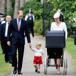Britain's Prince William, Kate the Duchess of Cambridge, their son Prince George and their daughter Princess Charlotte arrive for Charlotte's Christening at St. Mary Magdalene Church in Sandringham, England, Sunday.