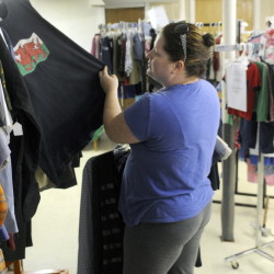 Shyanne Smart, of West Gardiner, shops for items at the Clothes Closet in Gardiner on Thursday.