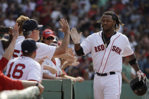 Boston's Hanley Ramirez is welcomed to the dugout after hitting a two-run home run in the seventh inning against the Houston Astros on Sunday at Fenway Park in Boston.