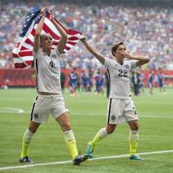AP photo USA teammates Becky Sauerbrunn, left, and Meghan Klingenberg celebrate following their championship win over Japan at the FIFA Women's World Cup on Sunday in Vancouver, British Columbia, Canada.