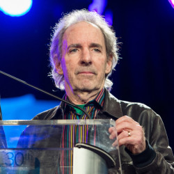 "The Associated Press In this Jan. 24, 2015 file photo, Harry Shearer appears at the 30th annual TEC Awards during the 2015 National Association of Music Merchants (NAMM) show in Anaheim, Calif. Shearer and his many voices are returning to ""The Simpsons"" after a contentious and public contract dispute."