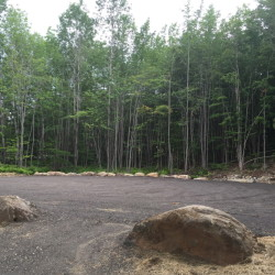 A couple wishing to remain anonymous bought the lot behind Bass Park for the construction of a new parking lot that was opened officially Tuesday. The lot can hold up to a dozen vehicles and is one of a list of improvements the town plans for the park.