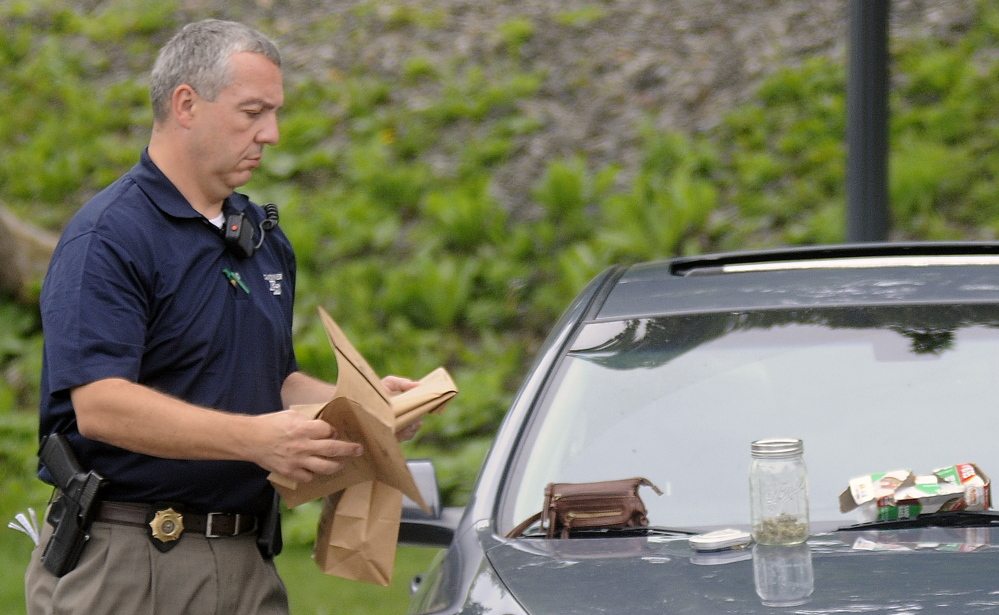 Gardiner Police Chief Jim Toman prepares to seize drugs Wednesday from a vehicle at the park on the Kennebec River in Gardiner.