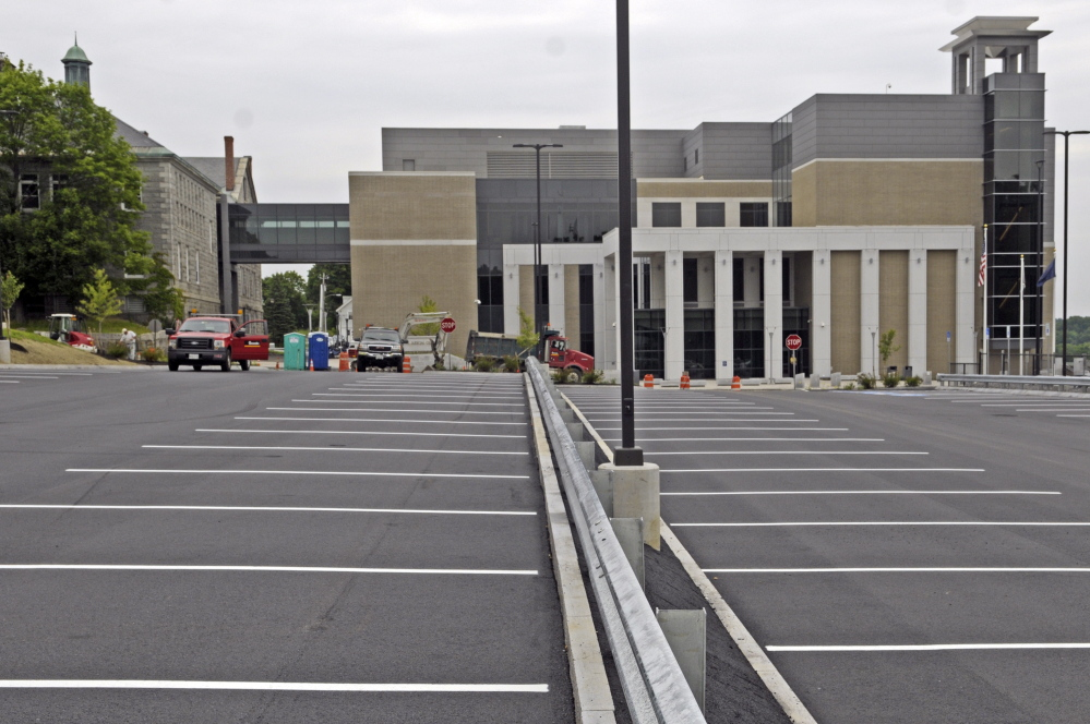 A new public parking lot in front of the Capital Judicial Center in Augusta had stripes painted on it Thursday.