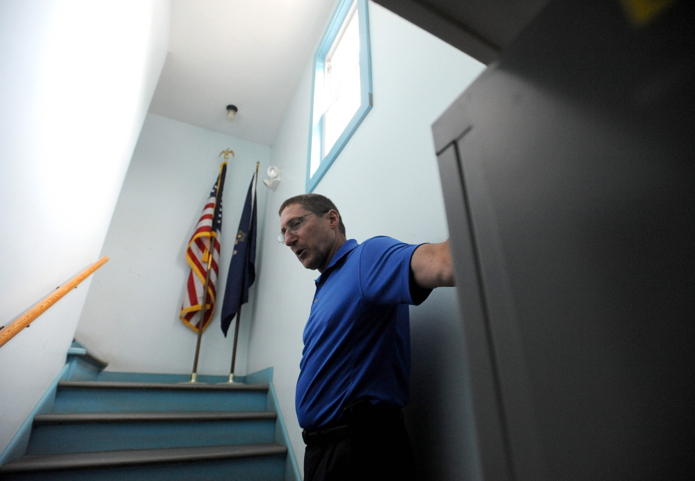 Michael Tracy, chief of the Oakland Police Department, gives a tour of the police station Thursday in Oakland.