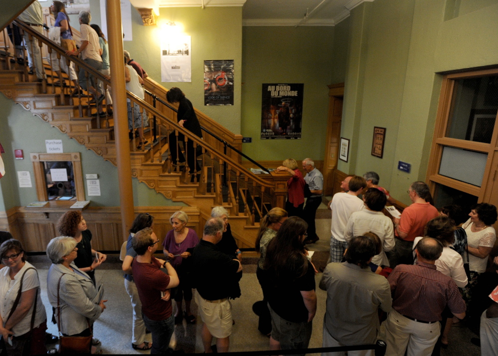 "People wait in line Friday night in the Waterville Opera House hallway for the movie ""Tumbledown"" to kick off the opening night of the Maine International Film Festival in Waterville."