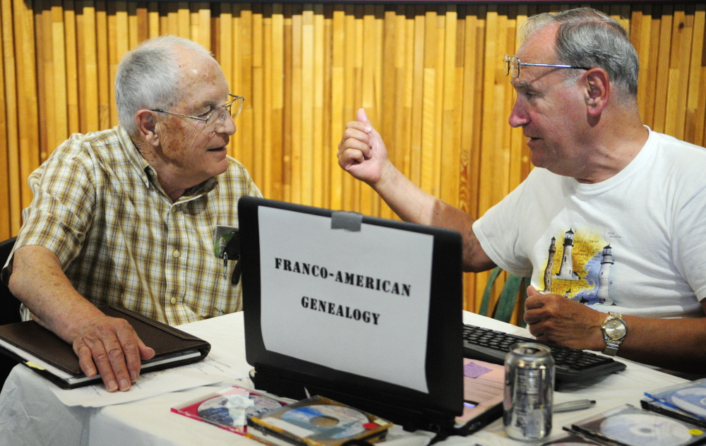 Eugene Moreau, left, of Farmingdale, gets advice from genealogy consultant Bob Chenard on Saturday during the 2015 Maine Genealogy Fair in the Maine State Cultural Building in Augusta.
