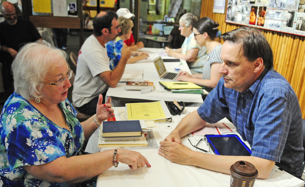 Lorna Fanjoy, left, of Auburn, gets advice from genealogy consultant Craig Siulinski on Saturday during the 2015 Maine Genealogy Fair in the Maine State Cultural Building in Augusta.
