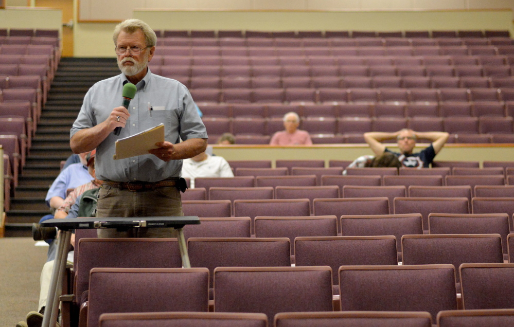 Tim Russell, of Sidney, speaks on June 18 during a Regional School Unit 18 district budget meeting at Messalonskee High School.