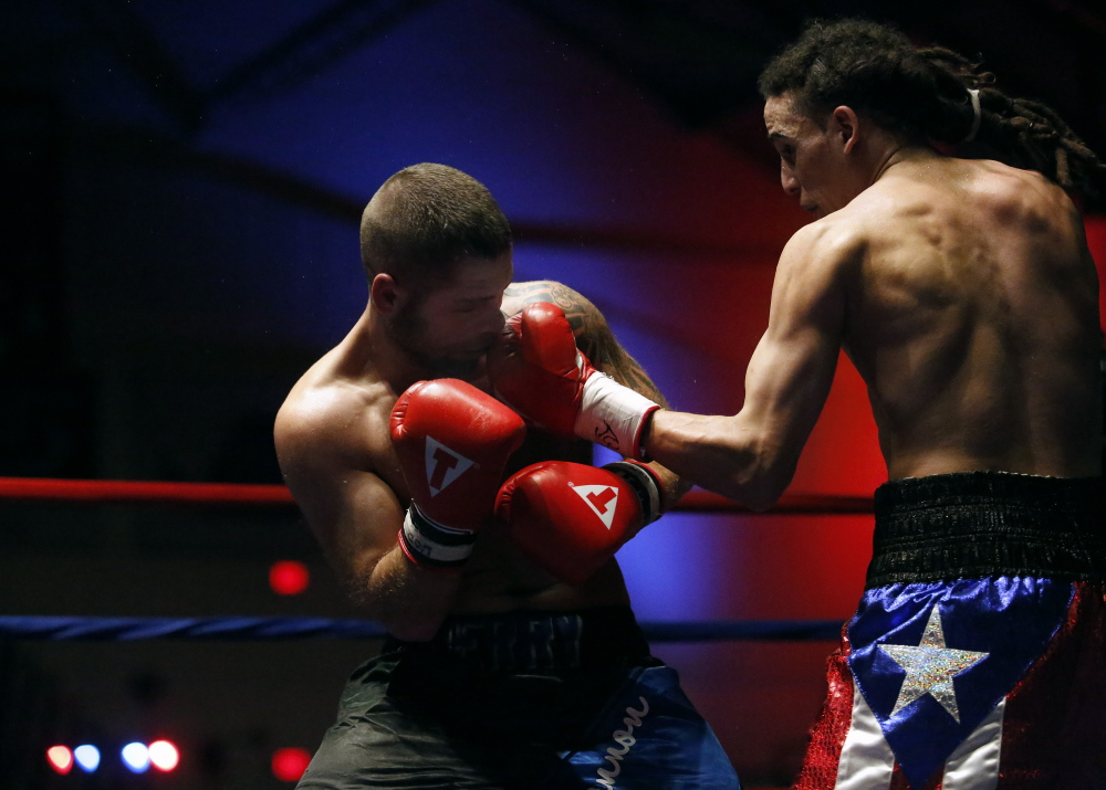 Portland Press Herald photo by Derek Davis   Freddie Sanchez, of Worcester, Mass., lands a punch on Brandon Berry, of West Forks, during a light welterweight bout at the Portland Expo last November.