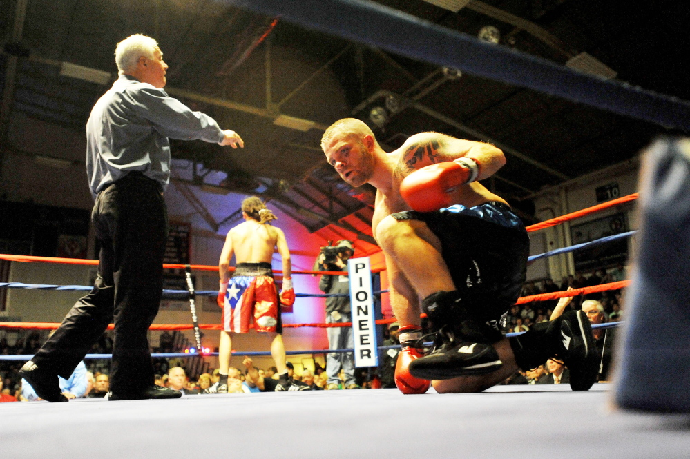 Staff file photo by Michael G. Seamans   Brandon Berry, right, kneels in the ring at the Portland Expo after losing by TKO to Freddy Sanchez, of Worcester, Mass.,  in the third round of a fight last November.