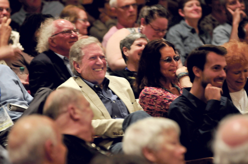 "Actor Michel Murphy, center, laughs on Thursday with members of the audience who came to see his movie ""Fall"" prior to Murphy being awarded the Mid-Life Achievement Award during a Maine International Film Festival event in Waterville."