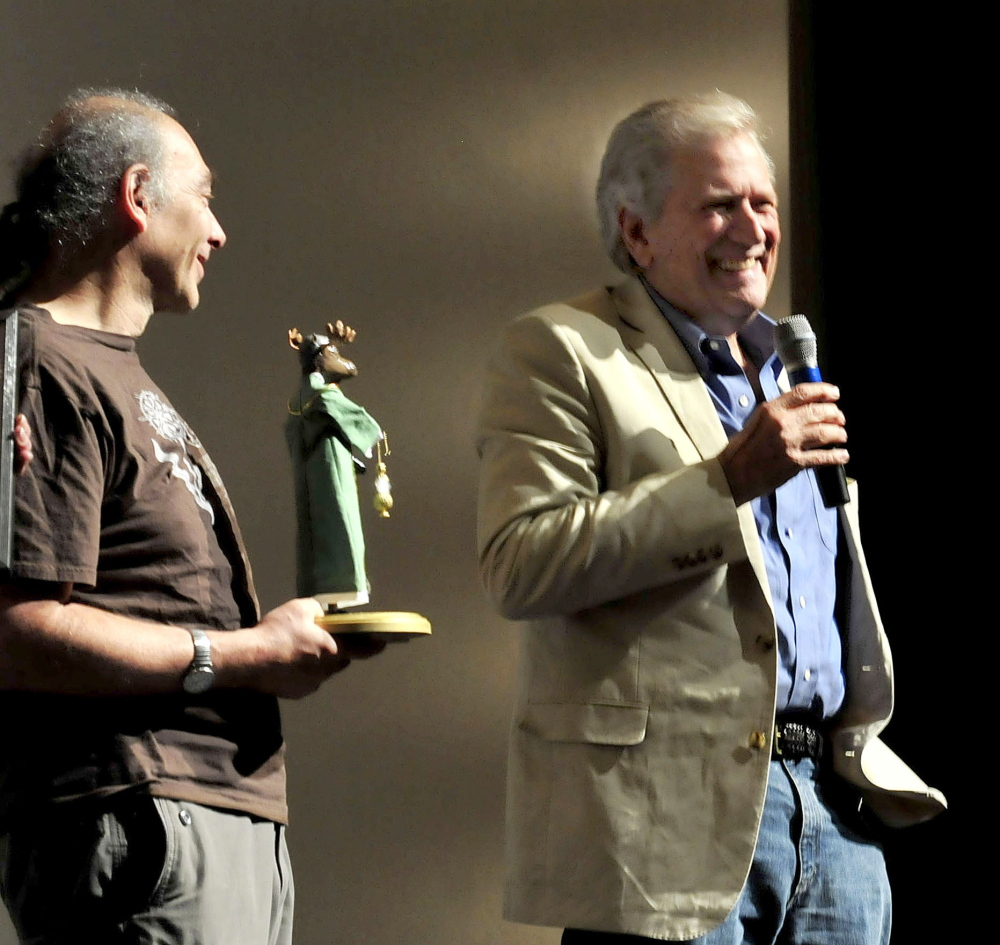 Actor and Maine International Film Festival Mid-Life Achievement Award winner Michael Murphy, right, laughs on Thursday at the sight of the moose trophy he received from MIFF programmer Ken Eisen.