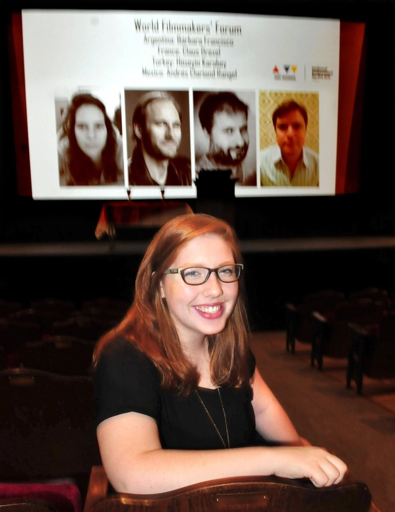 "Caroline Wheeler sits in the Waterville Opera House on Saturday as people arrive to view entries in the 38th Maine Student Film and Video Festival. Wheeler, a student at Waterville Senior High School, received an honorable mention as director of her entry, ""Three."""