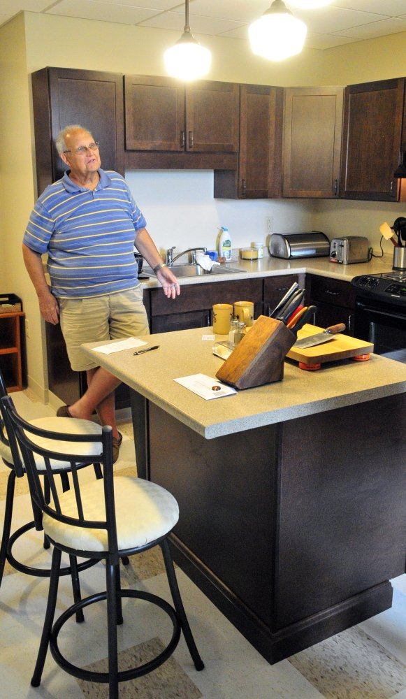 "Resident Jim ""Whit"" Whitten talks on Wednesday in his new apartment in the Cony Flatiron Senior Residence in Augusta."
