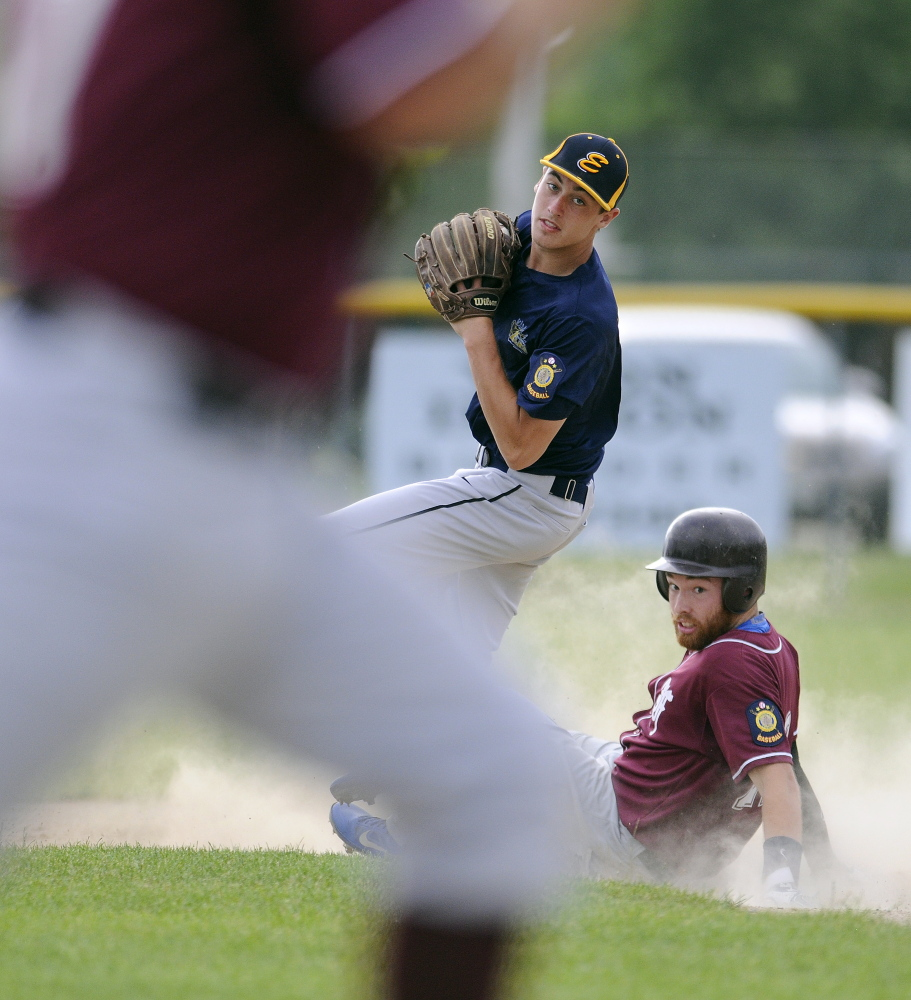 Staff photo by Andy Molloy   Augusta's Ryan Rodrigue can't turn a double play as Farmington's Andrew Pratt slides into second during an American Legion game in Augusta last week. Augusta and Farmington open tournament play this week.
