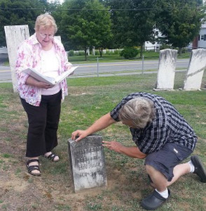 Guides Kay Marsh and David James examine the grave stone of Tilly Mason, Revolutionary Soldier at Southside Cemetery.